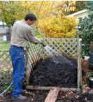composting_IL_extension_man_watering_compost